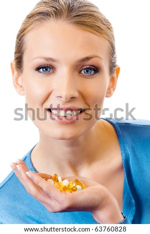 Woman with assorted pills and capsules, isolated on white - stock photo