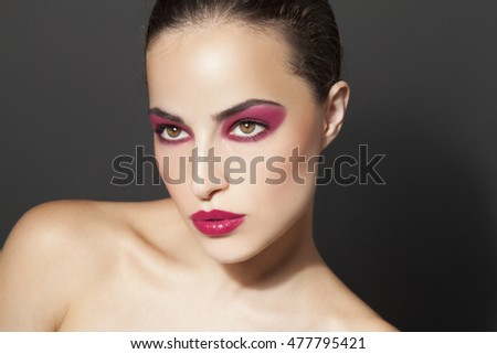 woman with attractive red makeup, beauty portrait, studio closeup