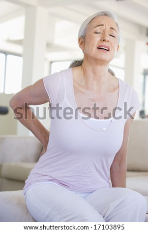 Woman With Back Pain - stock photo