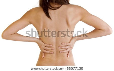 Woman with backache from behind, naked body. - stock photo