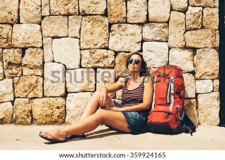 Woman with backpack - stock photo