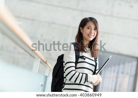 Woman with backpack and hold with laptop computer - stock photo