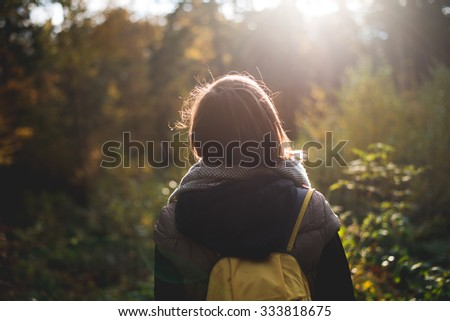 Woman with backpack on journey - stock photo