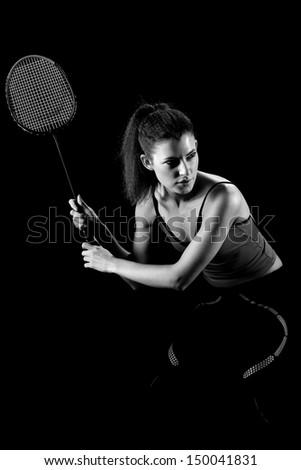 woman with badminton racket . Black and white photo - stock photo