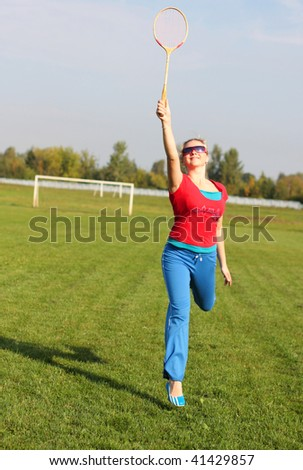 woman with badminton racquet - stock photo
