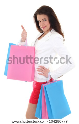 Woman with  bags showing thumbs up over white - stock photo