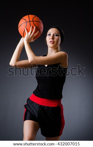Woman with basketball in sport concept - stock photo