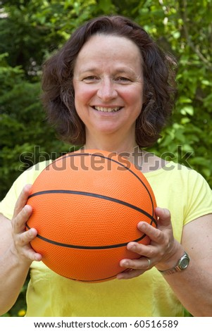 Woman with basketball- outdoor shooting