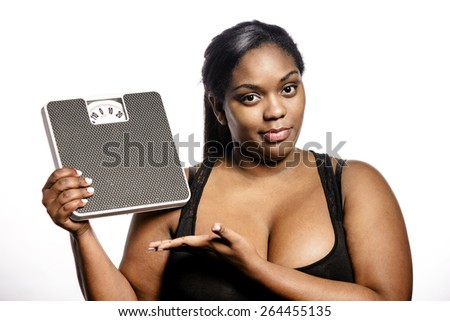 Woman with bathroom scale - stock photo