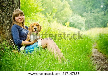 woman with beagle dog in the park
