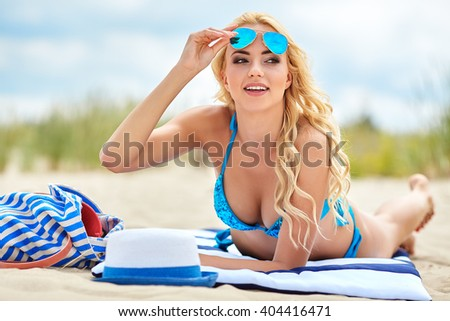 Woman with beautiful body on a baltic  beach