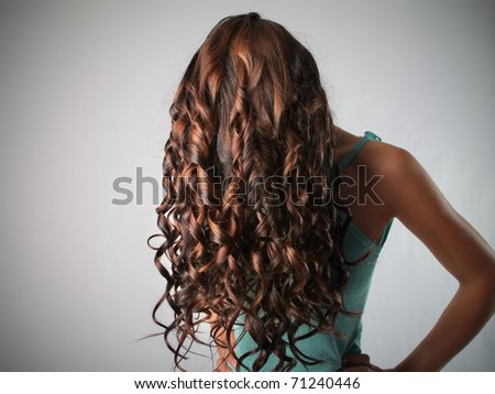 Woman with beautiful curly hair - stock photo