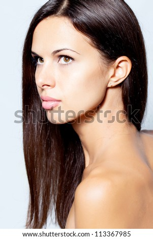 Woman with beautiful hair in studio - stock photo