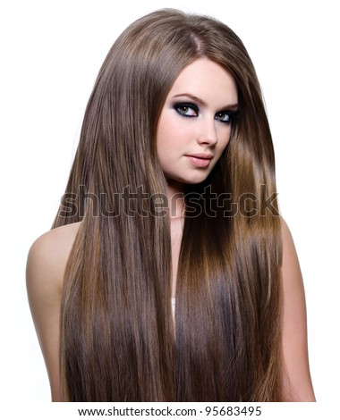 Woman with beautiful healthy  long straight hair - isolated on white background - stock photo