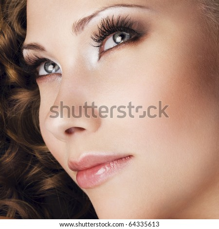 Woman with beautiful makeup and extremely long eyelashes - stock photo