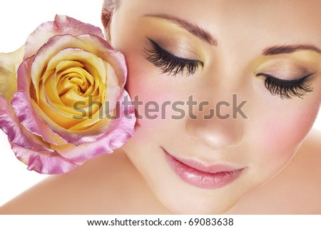 Woman with beautiful makeup and tender rose - stock photo