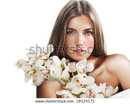 Woman with beautiful makeup and white orchids - stock photo