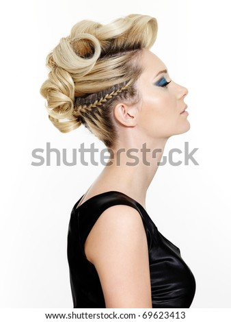 Woman with beautiful modern hairstyle -  isolated on white background - stock photo