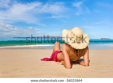 woman with beautiful pink sarong on tropical beach