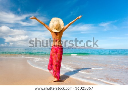 woman with beautiful pink sarong on tropical beach - stock photo