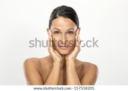 Woman with beauty face and cared skin - stock photo