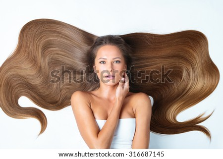 Woman with beauty long brown hair - stock photo