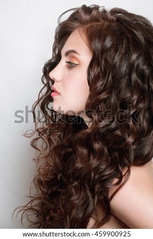 Woman with beauty long brown hair - posing at studio