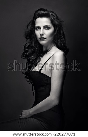 Woman with beauty long brown hair - posing at studio. Black and white - stock photo