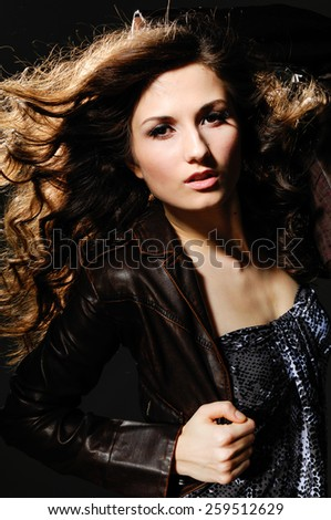 Woman with beauty long hair-black background - stock photo