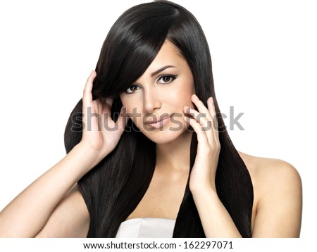 Woman with beauty long straight hair. Pretty young girl with beautiful hairstyle.  - stock photo