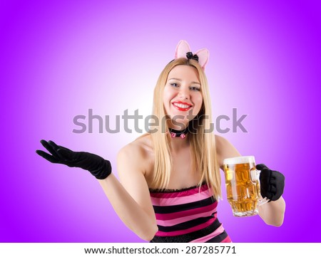 Woman with beer against the gradient - stock photo