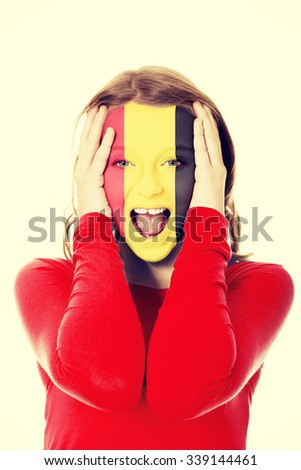 Woman with Belgium flag painted on face. - stock photo