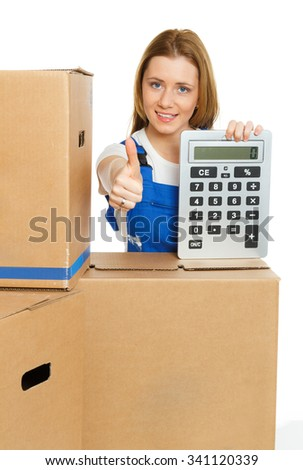 woman with big calculator and moving boxes shows thumb up - stock photo