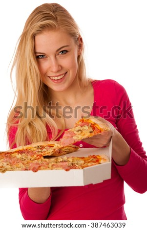 Woman with big delicious pizza in carton box can't wait to eat it. - stock photo