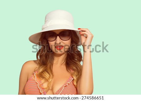Woman with bikini, hat and sunglasses - vacation concept, with copy space - stock photo