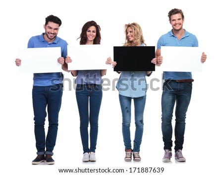 woman with black card looking to her side at her friends who hold white ones - stock photo