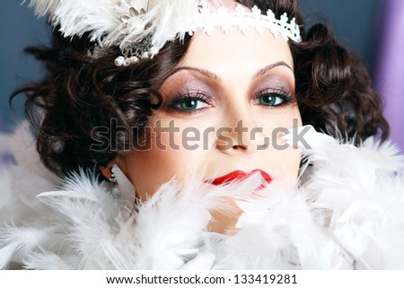 woman with black eye make-up smoky. Close-up face - stock photo