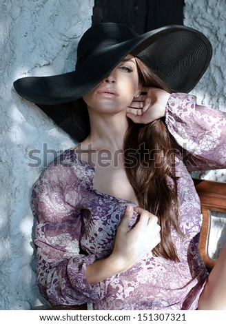 Woman with black hat - stock photo