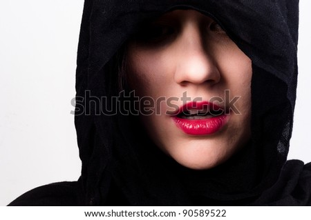 Woman with black hood against white isolated background - stock photo