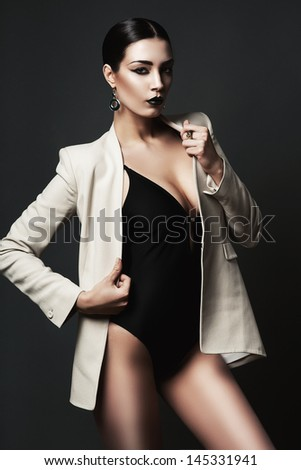 woman with black lips in blazer - stock photo