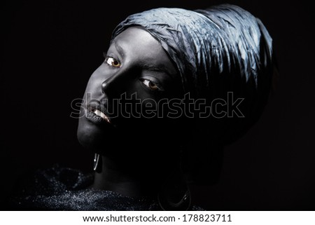 Woman with black skin in African turban. Studio shot