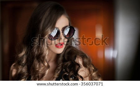 Woman with black sunglasses  and long curly hair. Beautiful woman portrait. Fashion art photo of young model with sunglasses. Elegant female portrait isolated. Romantic. Beauty. Modern style - stock photo