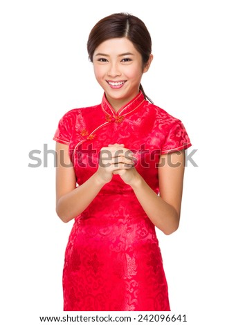 Woman with blessing gesture for lunar new year