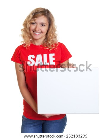 Woman with blond hair in a sale shirt holding a signboard - stock photo