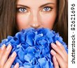Woman with blue flowers - stock photo