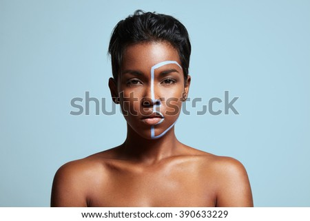 woman with  blue line on a face - stock photo