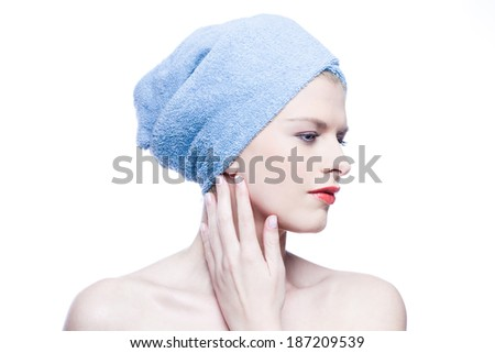 Woman with blue towel isolated on white - stock photo