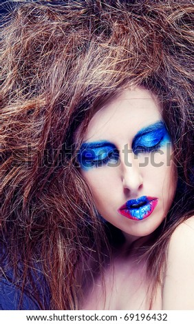 woman with blue visage. big hair.