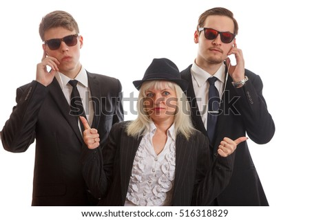 Woman with bodyguards