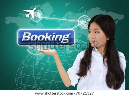 Woman with booking button on world map background - stock photo